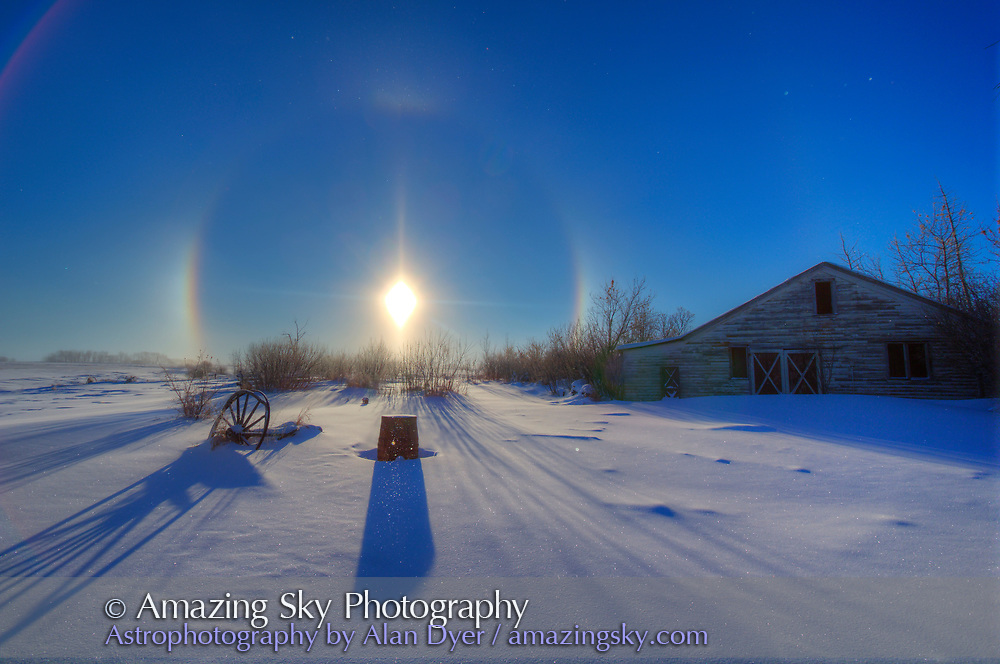 """Sundogs and a solar halo around the Sun, December 19, 2013, shot from home with the Canon 60Da and 10-22mm lens. The halo is caused by ice crystals in the air, in this case very nearby as they can be seen as """"stars"""" sparkling in the sunlight in the sky and in the foreground. This is an HDR stack of three exposures at 2/3rds stop intervals, processed thru Photomatix Pro."""