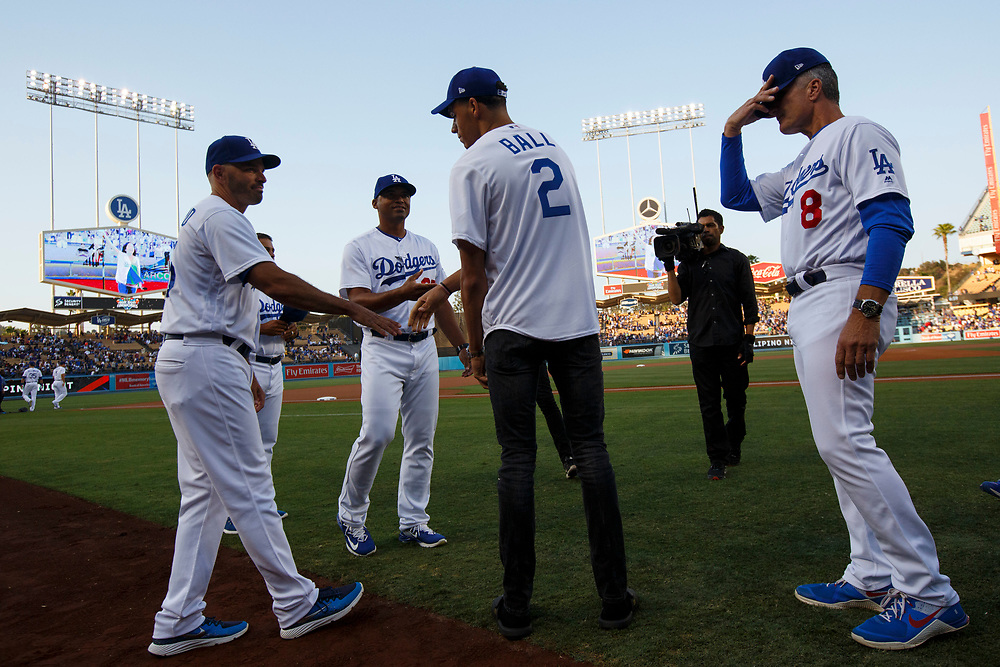 Lakers draft pick Lonzo Ball shakes hands after the national anthem before throwing out the first pitch at Dodger Stadium on Friday, June 23, 2017 in El Segundo, California. The Lakers selected Lonzo Ball as the No. 2 overall NBA draft pick and is the son of LaVar Ball. © 2017 Patrick T. Fallon
