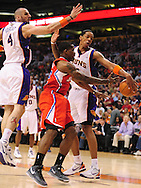 Apr. 1, 2011; Phoenix, AZ, USA; Los Angeles Clippers guard Eric Bledsoe (12) makes a pass that is blocked by the Phoenix Suns forward Channing Frye (8) as teammate Marcin Gortat (4) plays defense at the US Airways Center. The Suns defeated the Clippers 111-98. Mandatory Credit: Jennifer Stewart-US PRESSWIRE