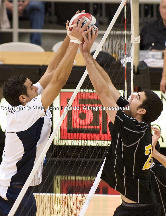 Edgardo Goas(left) and Dan Alexander(right) battle at the net in the Active Ankle Tournament match at the Walter Pyramid, Long Beach CA, Saturday, March 14, 2009.  Long Beach State wins the match in five sets 30-26, 30-24, 23-30, 27-30, 15-11.