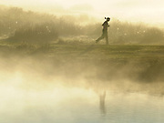 © Licensed to London News Pictures. 15/10/2011. A woman on an early morning jog around a lake in the autumnal sunrise. Richmond, UK. Early morning in Richmond Park, Surrey today 15 October 2011. Temperatures are set to fall across the UK in the coming week as Autumn takes hold. Photo: Stephen Simpson/LNP