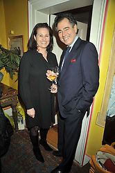 MANOLI OLYMPITIS and HENRIETTA, COUNTESS OF CALEDON at a party to celebrate the publication of Charles Glass's new book 'Americans in Paris' held at 12 Lansdowne Road, London W1 on 25th March 2009.