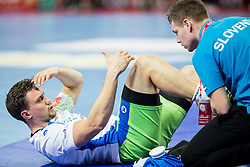 Darko Cingesar of Slovenia with Zan Rant Roos, physiotherapist  during handball match between National teams of Germany and Slovenia on Day 6 in Preliminary Round of Men's EHF EURO 2016, on January 20, 2016 in Centennial Hall, Wroclaw, Poland. Photo by Vid Ponikvar / Sportida