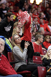 14 February 2016: A young Reggie Redbird Club dance clinic participant cheers on the Redbirds while standing on the lap of Melissa Muller during the Illinois State Redbirds v Bradley Braves at Redbird Arena in Normal Illinois (Photo by Alan Look)