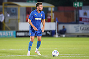 AFC Wimbledon defender Luke O'Neill (2) about to pass the ball during the Pre-Season Friendly match between AFC Wimbledon and Bristol City at the Cherry Red Records Stadium, Kingston, England on 9 July 2019.