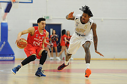 Bristol Flyers' Roy Owen is chased down by London Lions Lovell Cook - Photo mandatory by-line: Dougie Allward/JMP - Mobile: 07966 386802 - 28/03/2015 - SPORT - Basketball - Bristol - SGS Wise Campus - Bristol Flyers v London Lions - British Basketball League