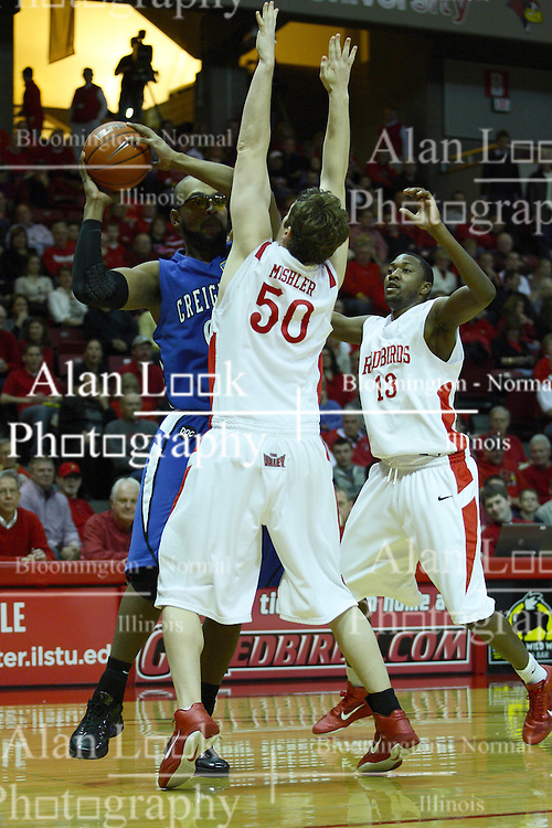 29 December 2010: Blake Mishler holds off Gregory Echenique during an NCAA basketball game where the Creighton Bluejays defeated the Illinois State Redbirds at Redbird Arena in Normal Illinois.