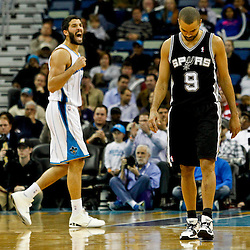 Jan 7, 2013; New Orleans, LA, USA; San Antonio Spurs point guard Tony Parker (9) and New Orleans Hornets point guard Greivis Vasquez (21) react following a turnover during the fourth quarter of a game at the New Orleans Arena. The Hornets defeated the Spurs 95-88. Mandatory Credit: Derick E. Hingle-USA TODAY Sports