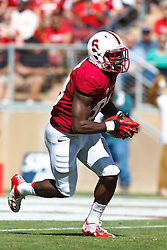 PALO ALTO, CA - OCTOBER 06: Wide receiver Ty Montgomery #88 of the Stanford Cardinal returns a kick off against the Arizona Wildcats during the third quarter at Stanford Stadium on October 6, 2012 in Palo Alto, California. The Stanford Cardinal defeated the Arizona Wildcats 54-48 in overtime. (Photo by Jason O. Watson/Getty Images) *** Local Caption *** Ty Montgomery