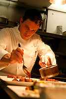 Chef Kaysen, Cafe Boulud, NY, saucing a magret de canard
