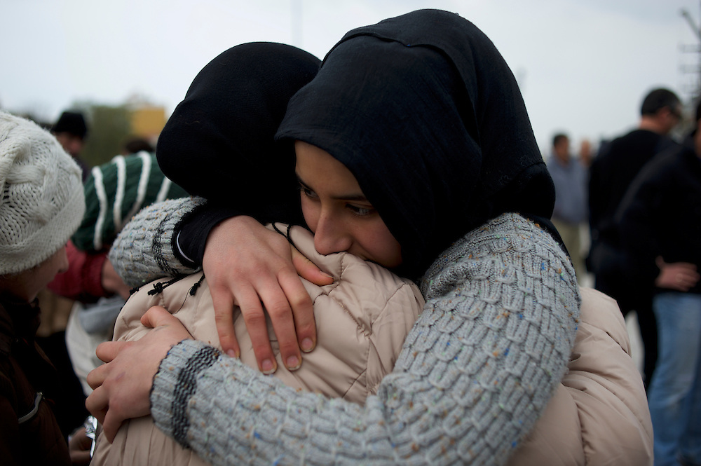Deniz Sidou, a Kurdish-Syrian refugee mother of six, hugs one of her daughters on arrival at Mytilene port in Lesbos. Deniz got separated from five of her children during a rescue operation in Turkish water two weeks before.