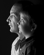 A father and son in black and white. The father in hard focus and the son in soft focus highlights the difference between the adult male and the male child.  Images by Paul Gregg a Durban portrait and fashion / lifestyle photographer.