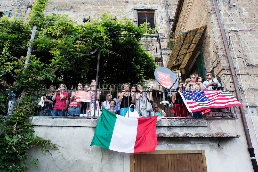 SANT'AGATA DE GOTI, ITALY - 23 JULY 2014:  Residents of Sant'Agata de Goti listen to the speeches of local government officials introdUcing Mayor of New York Bill De Blasio who will receive a honorary citizenship in Sant'Agata de Goti, his ancestral home town in Italy, on July 23rd 2014.<br /> <br /> New York City Mayor Bill de Blasio arrived in Italy with his family Sunday morning for an 8-day summer vacation that includes meetings with government officials and sightseeing in his ancestral homeland.
