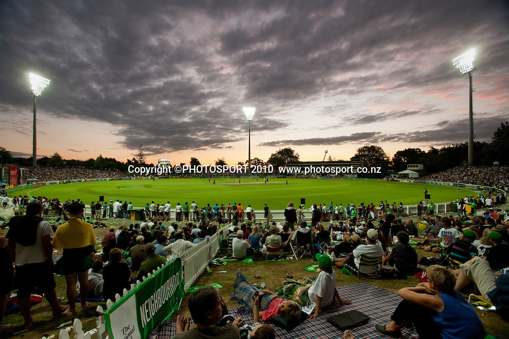 General view of crowd of fans on the bank with a sunset during the third one day Chappell Hadlee cricket series match between New Zealand Black Caps and Australia at Seddon Park, won by Australia by 6 wickets in Hamilton, New Zealand. Tuesday 9 March 2010. Photo: Stephen Barker/PHOTOSPORT