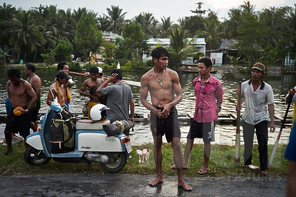A traditional Khmer river boat race training 20km outside of Ca Mau, Vietnam, Southeast Asia. These races are organized throughout the Mekong Delta and the team is training on the grounds of the Khmer Buddhist temple, their sponsoring organization.