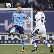 NEW YORK, NEW YORK - March 18: Maxime Chanot #4 of New York City FC clears while challenged by Ignacio Piatti #10 of Montreal Impact during the New York City FC Vs Montreal Impact regular season MLS game at Yankee Stadium on March 18, 2017 in New York City. (Photo by Tim Clayton/Corbis via Getty Images)