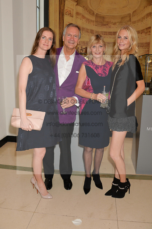 Left to right, CHLOE GRANT, CHARLES DELEVINGNE, PANDORA DELEVINGNE and POPPY DELEVINGNE at a Dinner to celebrate the launch of the Mulberry Cara Delevingne Collection held at Claridge's, Brook Street, London on 16th February 2014.