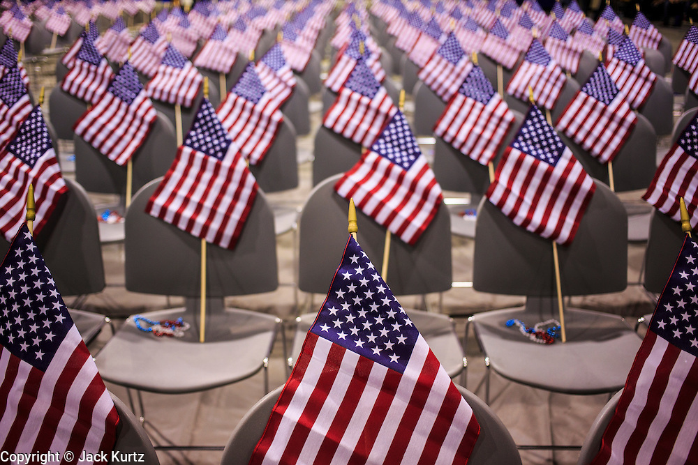 04 JULY 2012 - PHOENIX, AZ:  American flags on the new citizens' chairs in the auditorium before the naturalization ceremony Wednesday. About 250 people, from 62 countries, were naturalized as US citizens during the 24th Annual Fiesta of Independence naturization ceremony at South Mountain Community College in Phoenix Wednesday. The ceremony was presided over by the Honorable Roslyn O. Silver, Chief United States District Court Judge.   PHOTO BY JACK KURTZ