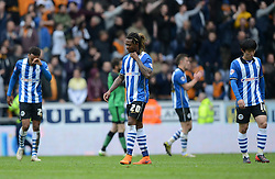 The Wigan players look dejected as the final whistle is blown - Photo mandatory by-line: Richard Martin-Roberts/JMP - Mobile: 07966 386802 - 25/04/2015 - SPORT - Football - Wigan - DW Stadium - Wigan Athletic v Wolverhampton Wanderers - Sky Bet Championship