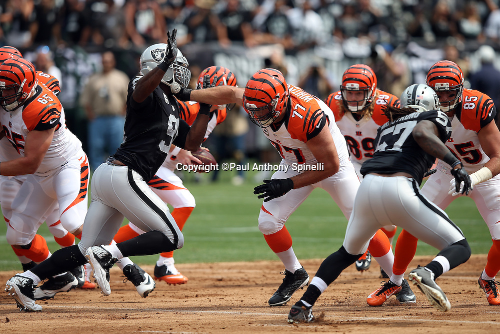 Oakland Raiders defensive end Justin Tuck (91) is blocked while rushing by Cincinnati Bengals tackle Andrew Whitworth (77) during the 2015 NFL week 1 regular season football game against the Cincinnati Bengals on Sunday, Sept. 13, 2015 in Oakland, Calif. The Bengals won the game 33-13. (©Paul Anthony Spinelli)