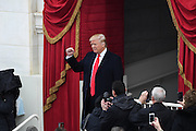 President-elect Donald Trump holds up his fist after arriving for the 68th Inaugural Ceremony to become the 45th President on Capitol Hill January 20, 2017 in Washington, DC.