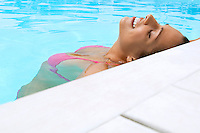 Woman Relaxing in Swimming Pool close up
