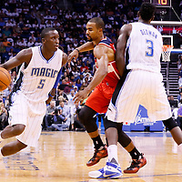 28 October 2015: Orlando Magic guard Victor Oladipo (5) drives past Washington Wizards guard Ramon Sessions (7) on a screen set by Orlando Magic center Dewayne Dedmon (3) during the Washington Wizards 88-87 victory over the Orlando Magic, at the Amway Center, in Orlando, Florida, USA.