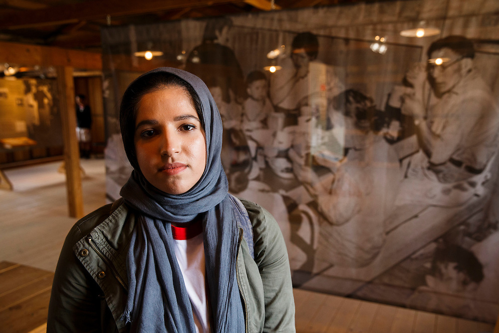 Amara Munir, a muslim American, stands for a portrait in the mess hall at the Manzanar National Historic Site during the 47th Annual Manzanar Pilgrimage on Saturday, April 30, 2016 in the Owens Valley of Inyo County, Calif. Now a National Historic Site, the Manzanar War Relocation Center was one of ten camps where Japanese American citizens and resident Japanese aliens were interned during World War II. Photo by Patrick T. Fallon / Special to the National Parks Conservation Association