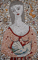 Stone mosaic of a woman holding a dove in Minusio, Ticino, Southern Switzerland.
