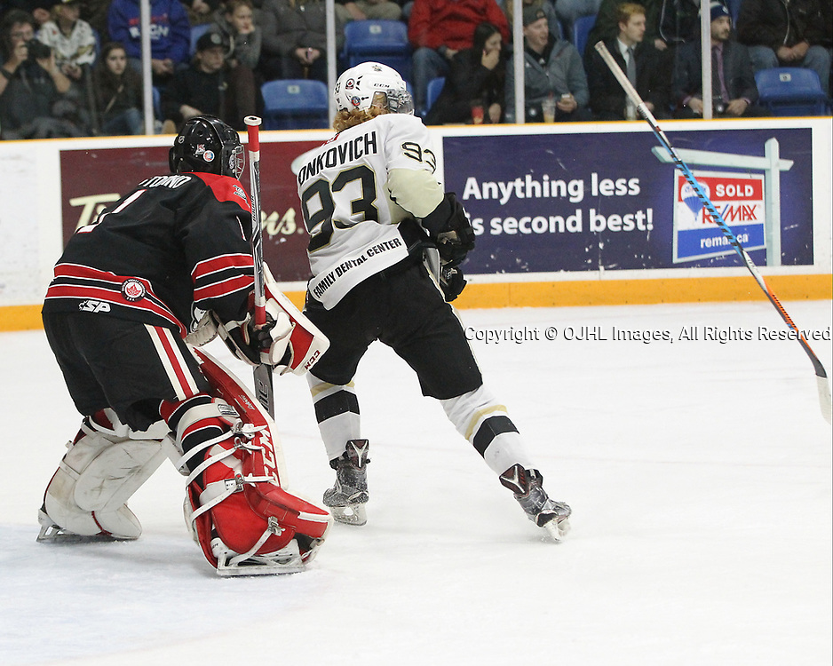 TRENTON, ON  - APR 15,  2017: Ontario Junior Hockey League, Championship Series. Georgetown Raiders vs the Trenton Golden Hawks in Game 2 of the Buckland Cup Final. Austin Tonkovich #93 of the Trenton Golden Hawks loses his stick while in the crease during the second period.<br /> (Photo by Tim Bates / OJHL Images)