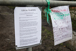Harefield, UK. 14 January, 2020. A notice previously posted by Stop HS2 activists at the end of a public right of way leading to a protection camp from which they are currently being evicted by enforcement agents working on behalf of HS2. 108 ancient woodlands are set to be destroyed by the high-speed rail link and further destruction of trees for HS2 in the Harvil Road area is believed to be imminent.