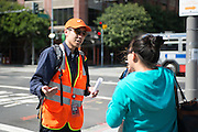 Jason, an SFMTA representative, helps a customer figure out which bus to take to the East Bay. A Bart strike caused chaos for commuters coming in and out of San Francisco. AC Transit and San Francisco Bay Ferry managed the trans bay commutes, while Muni handled the dissplaced commuters within San Francisco. | July 2, 2013