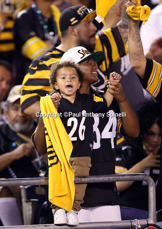 "The stadium crowd has a distinct Pittsburgh Steelers look to it as a young fan yells out and waves his ""Terrible Towel"" during the 2015 NFL week 5 regular season football game against the San Diego Chargers on Monday, Oct. 12, 2015 in San Diego. The Steelers won the game 24-20. (©Paul Anthony Spinelli)"