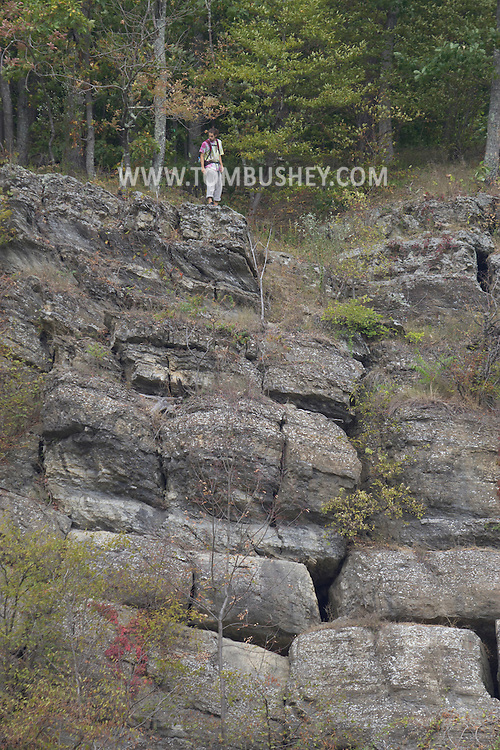 Rosendale, New York - A hiker takes in the view on Joppenbergh Mountain during the Shawangunk Ridge Trail Run/Hike 32-mile race on Sept. 20, 2014.