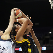 Elizabeth Cambage, Tulsa Shock, is blocked by Kelsey Griffin, (left), and  Mistie Bass, Connecticut Sun, during the Connecticut Sun V Tulsa Shock WNBA regular game at Mohegan Sun Arena, Uncasville, Connecticut, USA. 2nd July 2013. Photo Tim Clayton
