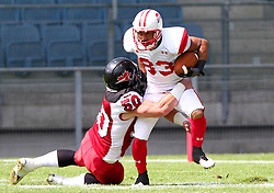 13.07.2011, UPC Arena, Graz, AUT, American Football WM 2011, Group B, Japan (JAP) vs Canada (CAN), im Bild tackle from Steve Faoro (Canada, #50, LB) against Ken Shimizu (Japan, #83, WR)  // during the American Football World Championship 2011 Group B game, Japan vs Canada, at UPC Arena, Graz, 2011-07-13, EXPA Pictures © 2011, PhotoCredit: EXPA/ T. Haumer