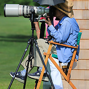 A photographer shoots the game in comfort during the Airstream vs. Cinque Terre Polo match at the Greenwich Polo Club, Greenwich, Connecticut, USA. 23rd June 2013. Photo Tim Clayton
