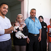 Judge Khalid, 48, and his family arrived in Jordan almost three years ago from Homs, Syria. Judge Khalid is a community leader in Mercy Corps&rsquo; conflict resolution program for Syrian refugees and Jordanians in Mafraq, Jordan. The program helps build a peaceful community between the two groups.<br /> <br /> Khalid and his family fled bombings so quickly, they had no time to bring any material things with them. The most important thing Khalid brought with him is his family. Mafraq, Jordan, May 2015.