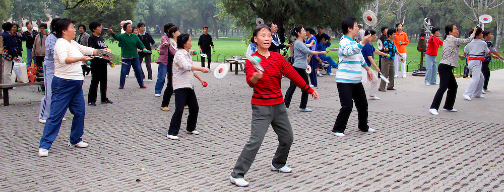 Asia, China, Beijing. Tai Chi with paddles in the Temple of heaven Park in Beijing.