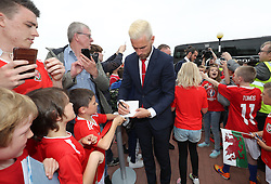 CARDIFF, WALES - Saturday, June 4, 2016: Wales' Aaron Ramsey and his team sign autographs for Ysgoal Treganna students as the team are given a colourful send off at Cardiff Airport as the squad head to Sweden for their last friendly before the UEFA Euro 2016 in France. (Pic by David Rawcliffe/Propaganda)