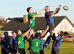 Westport Dave Keane reaches for line out ball ahead of Phillip Timoney during the junior league match against Ballina...Pic Conor McKeown