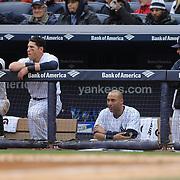 Watching from the New York Yankees dugout, from left,  Brett Gardner, Jacoby Ellsbury, Derek Jeter and Joe Girardi during the New York Yankees V Baltimore Orioles home opening day at Yankee Stadium, The Bronx, New York. 7th April 2014. Photo Tim Clayton