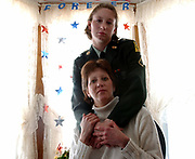 Sub2/12/03  Photo by Mara Lavitt-Scott&amp;Fouts 3<br /> ML0053A #9272<br /> Pfc. Kristina Scott Fouts top and her mom Spc. Brenda Scott at home in Cheshire just days before Kristina's deployment.