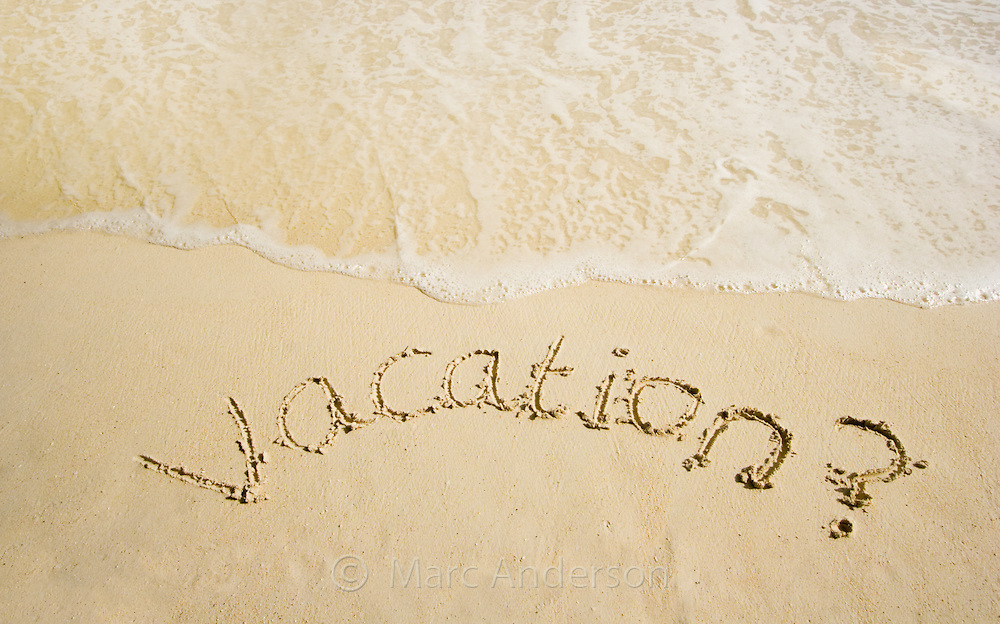 "The word ""VACATION"" written in sand on a tropical island in the Bacuit Archipelago, Philippines"