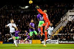 Bobby Reid of Bristol City is challenged by David Button of Fulham - Rogan/JMP - 31/10/2017 - Craven Cottage - London, England - Fulham FC v Bristol City - Sky Bet Championship.