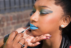 London, August 24th 2014. Final tweaks are applied to makeup as revellers prepare to participate in 2014's Notting Hill Carnival in London, celebratingWest Indian and other cultures, and attracting hundreds of thousands to Europe's biggest street party.