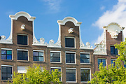 Traditional Dutch architecture - ornate decorative houses in Amsterdam, Holland
