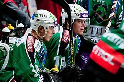 Eric Pance and Jure Kralj of HDD Tilia Olimpija during ice-hockey match between HDD Tilia Olimpija and HK Acroni Jesenice in second game of Final at Slovenian National League, on April 3, 2011 at Hala Tivoli, Ljubljana, Slovenia. (Photo By Matic Klansek Velej / Sportida.com)