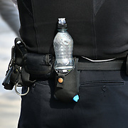 A policeman carry a water bottle guarding Day 8 Extinction Rebellion continue at Parliament, 22 April 2019,  London, UK