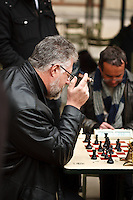 Men play chess in Luxembourg Garden, Paris, France.